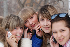 Portrait of the young girls. Portrait of the young girl with a phone stock image