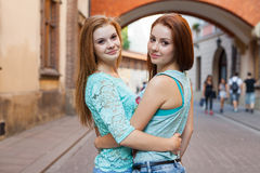 Portrait of young girls standing and hugging. Urban ba Stock Images