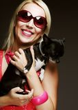 Portrait of young glamorous woman with toy-terrier Stock Photos