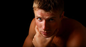 Portrait of young good looking male model. Shadowy dark close-up portrait of young good looking male model royalty free stock photo