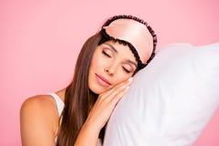 Portrait of young gorgeous smiling lady wearing eye mask sleepin royalty free stock photos