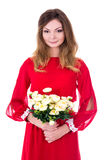 Portrait of young gorgeous woman in red dress with flowers isola Royalty Free Stock Photo