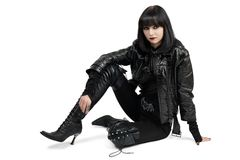Portrait of young goth woman in lace-up boots Royalty Free Stock Image
