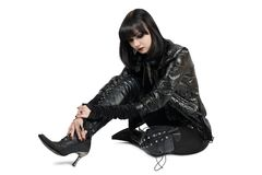Portrait of young goth woman in lace-up boots Royalty Free Stock Photography