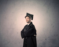 Portrait of a young graduate student on grungy background Royalty Free Stock Photo