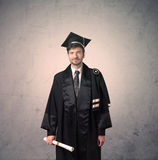 Portrait of a young graduate student on grungy background Royalty Free Stock Image