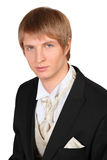 Portrait of young groom in black suit Stock Image