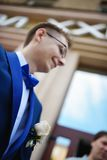 Portrait of young groom in blue tuxedo Royalty Free Stock Photos
