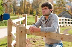 Portrait of young guy in country field Royalty Free Stock Photography