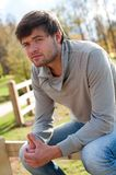 Portrait of young guy in country field Stock Images