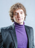 Portrait of a young guy with curly hair Royalty Free Stock Photography