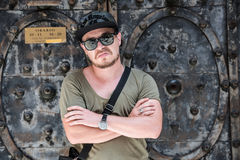 Portrait of a young rap guy. Portrait of a young guy dresses as a rapper with sunglasses a cool camouflage hat, jeans and nice stylish watch Royalty Free Stock Photos