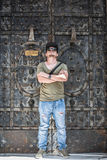 Portrait of a young rap guy. Portrait of a young guy dresses as a rapper with sunglasses a cool camouflage hat, jeans and nice stylish watch Stock Photography