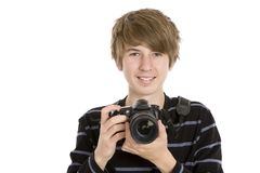 Teenager Taking a Photo. A portrait of a young guy with a DSLR camera, isolated on white Stock Image