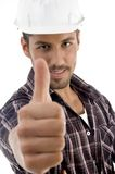 Portrait of young guy gesturing thubmbs up Royalty Free Stock Photos