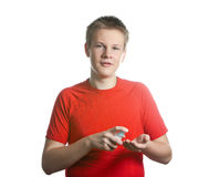 Portrait of the young guy in a red t-shirt Stock Photography