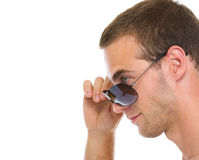 Portrait of young guy with sunglasses in profile Royalty Free Stock Photos