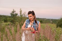 Portrait of a young gypsy in a field at sunset Stock Image