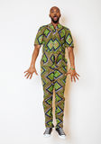 Portrait of young handsome african man wearing bright green national costume smiling gesturing Stock Photography