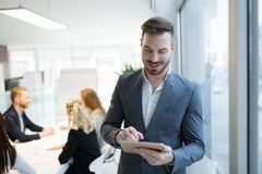 Portrait of young handsome architect on meeting. In office stock photography