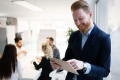 Portrait of young handsome architect on meeting. In office stock images