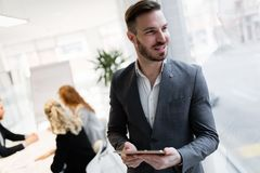 Portrait of young handsome architect on meeting. In office stock image