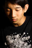 Portrait of young handsome asia man close eyes. Troubled - Portrait of young handsome asia man close eyes in black Stock Photo
