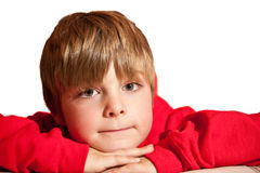 Portrait of young handsome boy wearing red hoodie. Portrait of young handsome oy wearing red hooded top against white background royalty free stock image