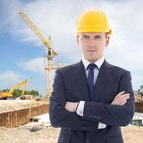 Portrait of young handsome business man in builder's helmet Stock Photos