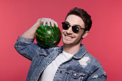 Portrait of young handsome casual man holding watermelon. Attractive young man Stock Photography