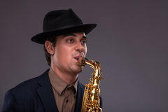 Portrait of a young handsome Caucasian jazz man in Stock Images