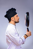 Portrait of young handsome cook Stock Image