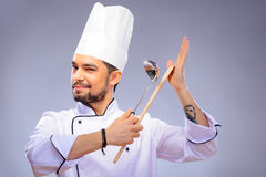 Portrait of young handsome cook Stock Images