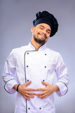 Portrait of young handsome cook Royalty Free Stock Photo