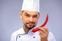Portrait of young handsome cook Stock Photos