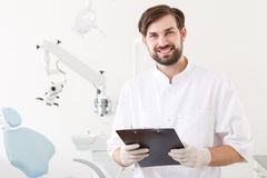 Portrait of young handsome dentist in clinic Royalty Free Stock Photography