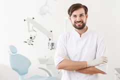 Portrait of young handsome dentist in clinic Royalty Free Stock Photos