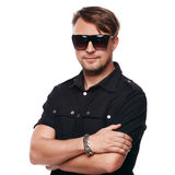 Portrait of young handsome fashion man wearing sunglasses. Isolated on white. Background Royalty Free Stock Photo