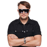 Portrait of young handsome fashion man wearing sunglasses. Isolated on white Royalty Free Stock Photography