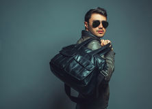 Portrait of young handsome fasion man with leather bag wearing s Stock Image