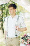 Portrait of young handsome groom outdoors. fine art photography royalty free stock images
