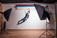 Portrait of a young hipster man in a studio, jumping. Copy space. Stock Images