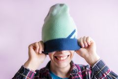 Portrait of young handsome male put on and wear hat isolated f royalty free stock photos