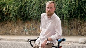 Portrait of young handsome man with beard leaning on vintage bicycle. Portrait of handsome man with beard leaning on vintage bicycle Royalty Free Stock Photos