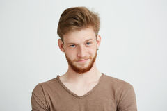 Portrait of young handsome man with beard looking at camera smiling over white background. Royalty Free Stock Photo