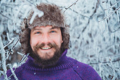 Portrait of a young handsome man with a beard. A person close up of a bearded man. Bearded man froze in the winter woods Royalty Free Stock Image