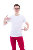 Portrait of young handsome man in blank t-shirt pointing at hims Stock Images