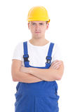 Portrait of young handsome man in blue builder uniform isolated Royalty Free Stock Images