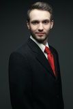 Portrait of young handsome man (businessman) in black suit Stock Images