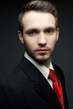 Portrait of a young handsome man (businessman) in black suit wit Royalty Free Stock Images